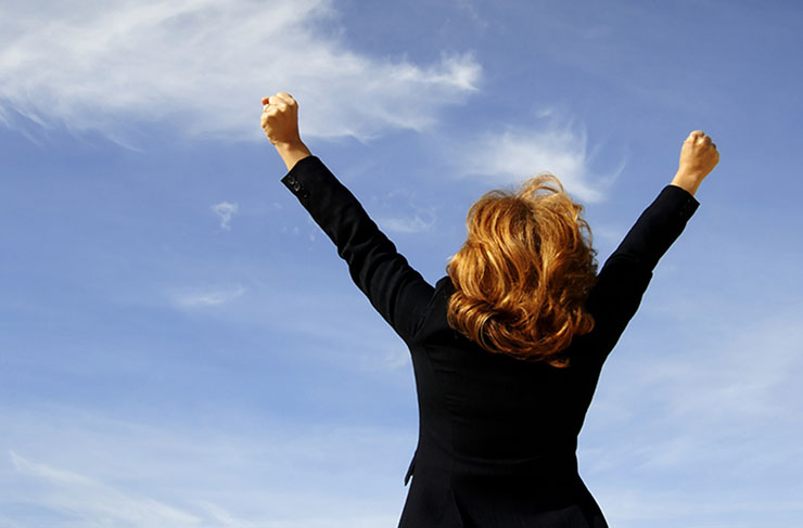 Businesswoman shouting her victory to the world